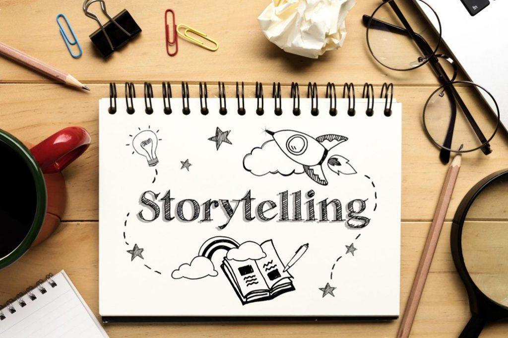 Un block note con un disegni di fantasia e il titolo Digital Storytelling